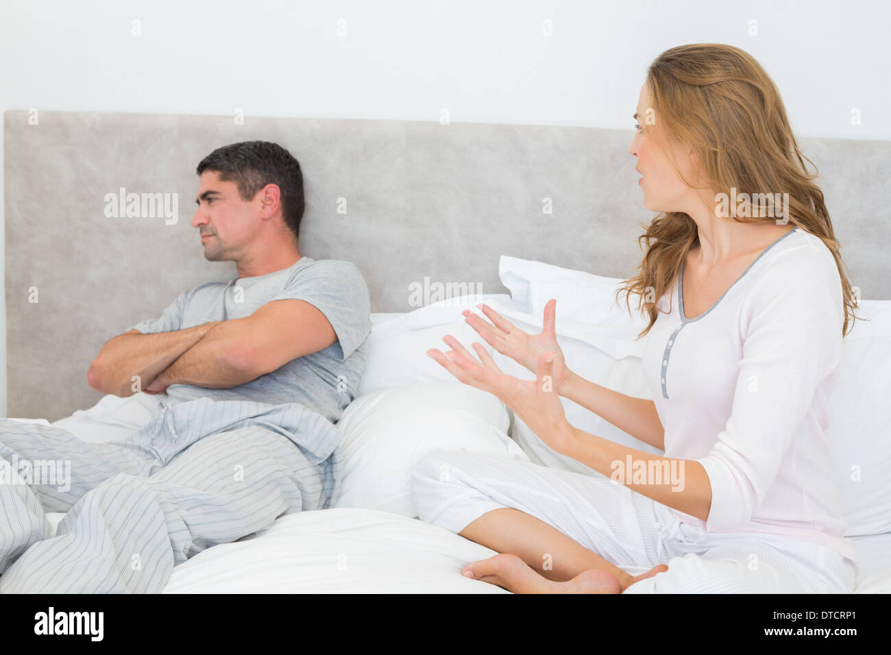 Couple arguing in bedroom - Stock Image