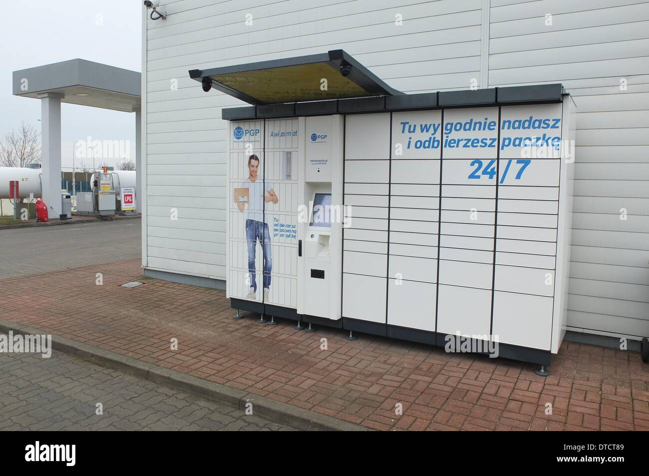 Gdansk, Poland 15th, February 2014 Polish InPost Company finalized an agreement with TFL - London's transport manager - under which the Parcel Lockers machines installation starts in car parks at London Underground stations. Pictured: Parcel Lockers machines belonging to Inpost and PGP S.A. consortium mounted in Gdansk at a petrol station. Credit:  Michal Fludra/Alamy Live News - Stock Image