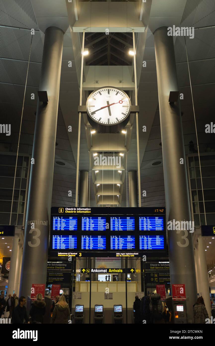 Clock and travel information in Copenhagen Airport, København, Denmark. - Stock Image