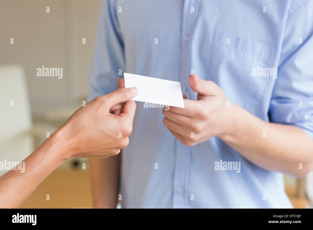 Business people exchanging visiting cards - Stock Image