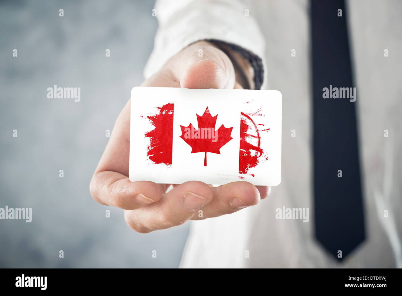 Canadian Businessman holding business card with Canada Flag Stock ...