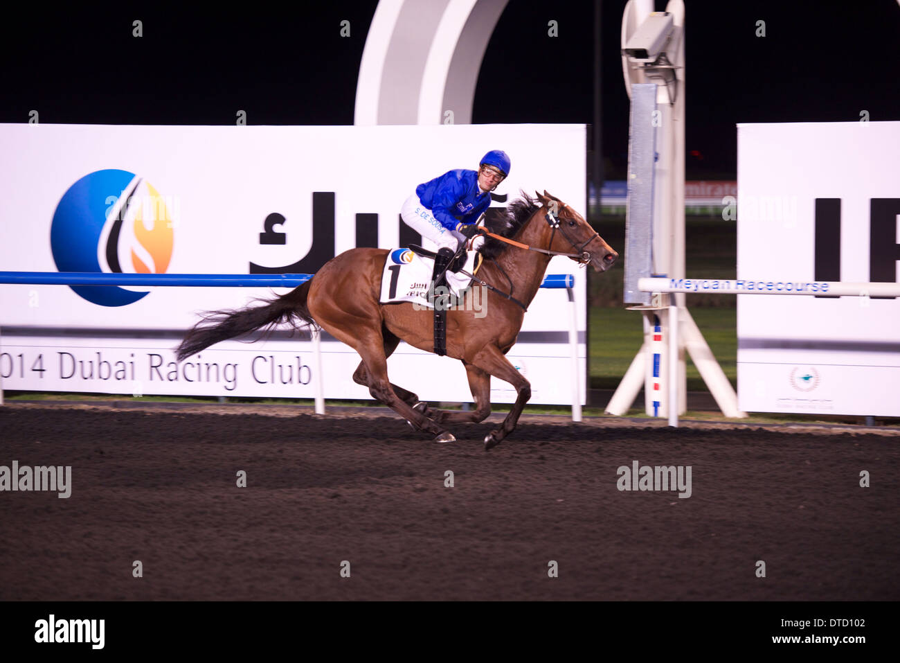 Race 4 of the 5th meeting of the 2014 Dubai World Cup Carnival was won for Godolphin by Silvestre De Sousa riding Ihtimal - Stock Image