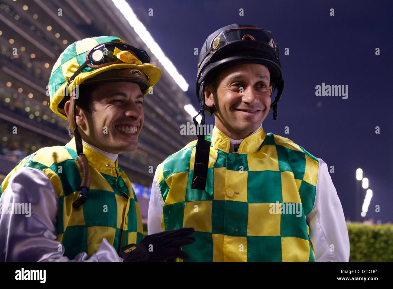 Godolphin Jockeys Royston Ffrench and Silvestre De Sousa in front of the Meydan Grandstand during the Dubai World Cup Carnival - Stock Image