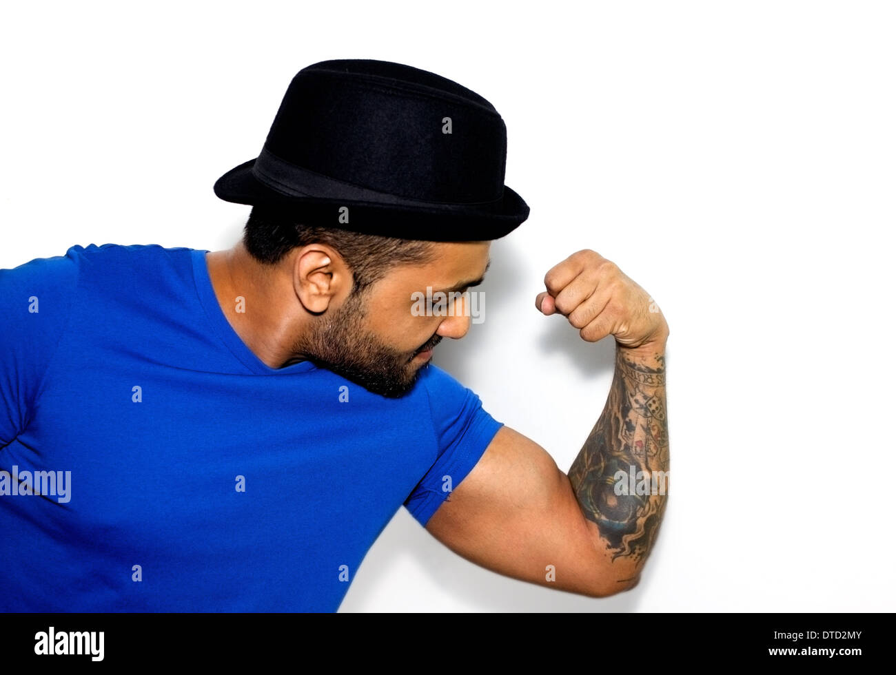 Ethnic Indian male with hat and tattoos 53c186312