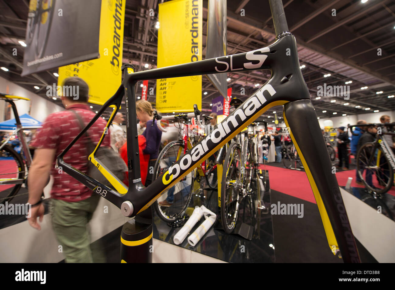 London, UK. 15th Feb, 2014 The UK's largest cycling exhibition showcases many new bikes and accessories. Boardman bikes stand with a presentation of the AiR/9.8 frame, an ultralight full carbon monocoque tapered headtube with internal cable routing. Credit:  Malcolm Park editorial/Alamy Live News - Stock Image