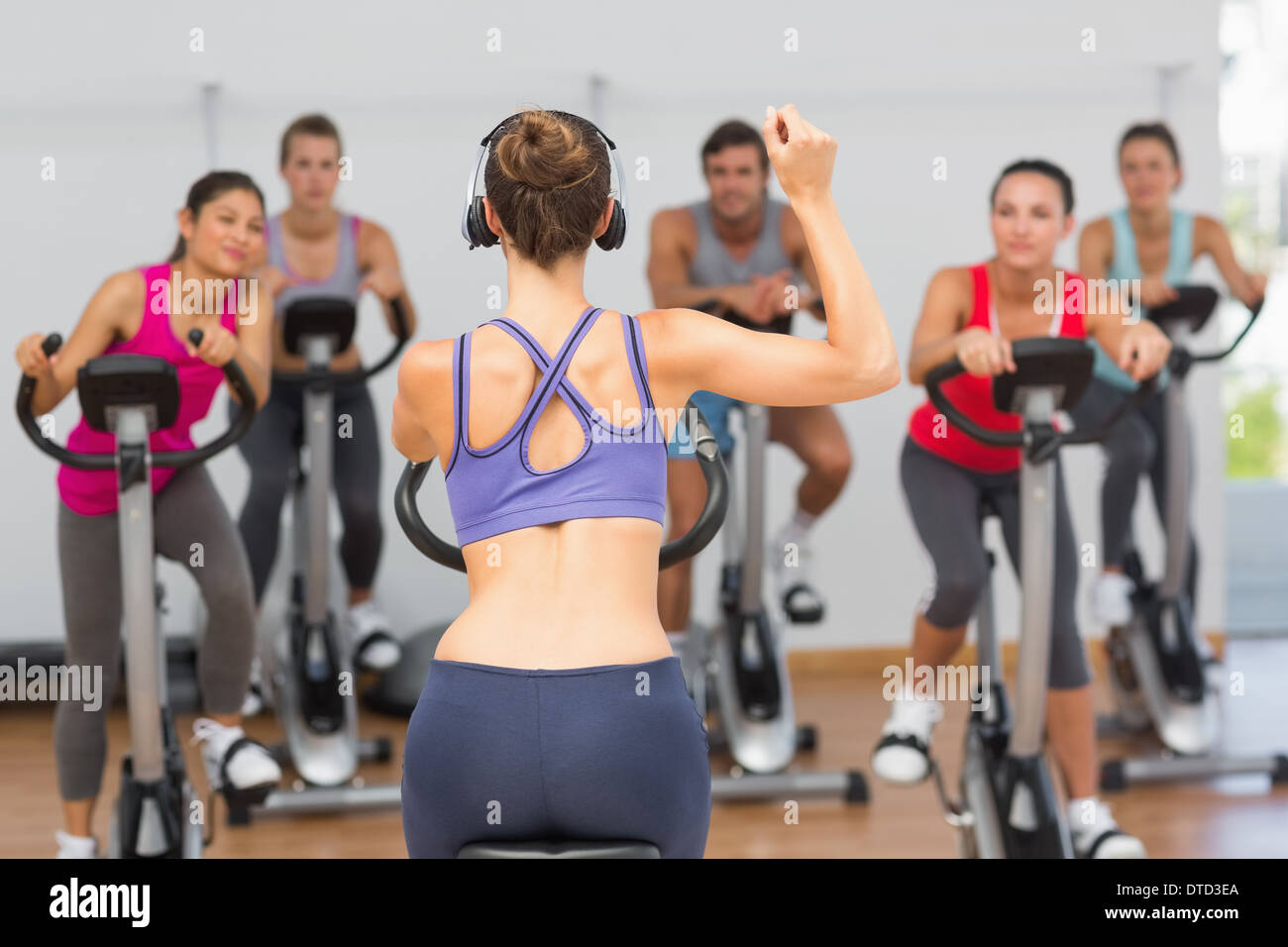 Trainer and fitness class at spinning class - Stock Image