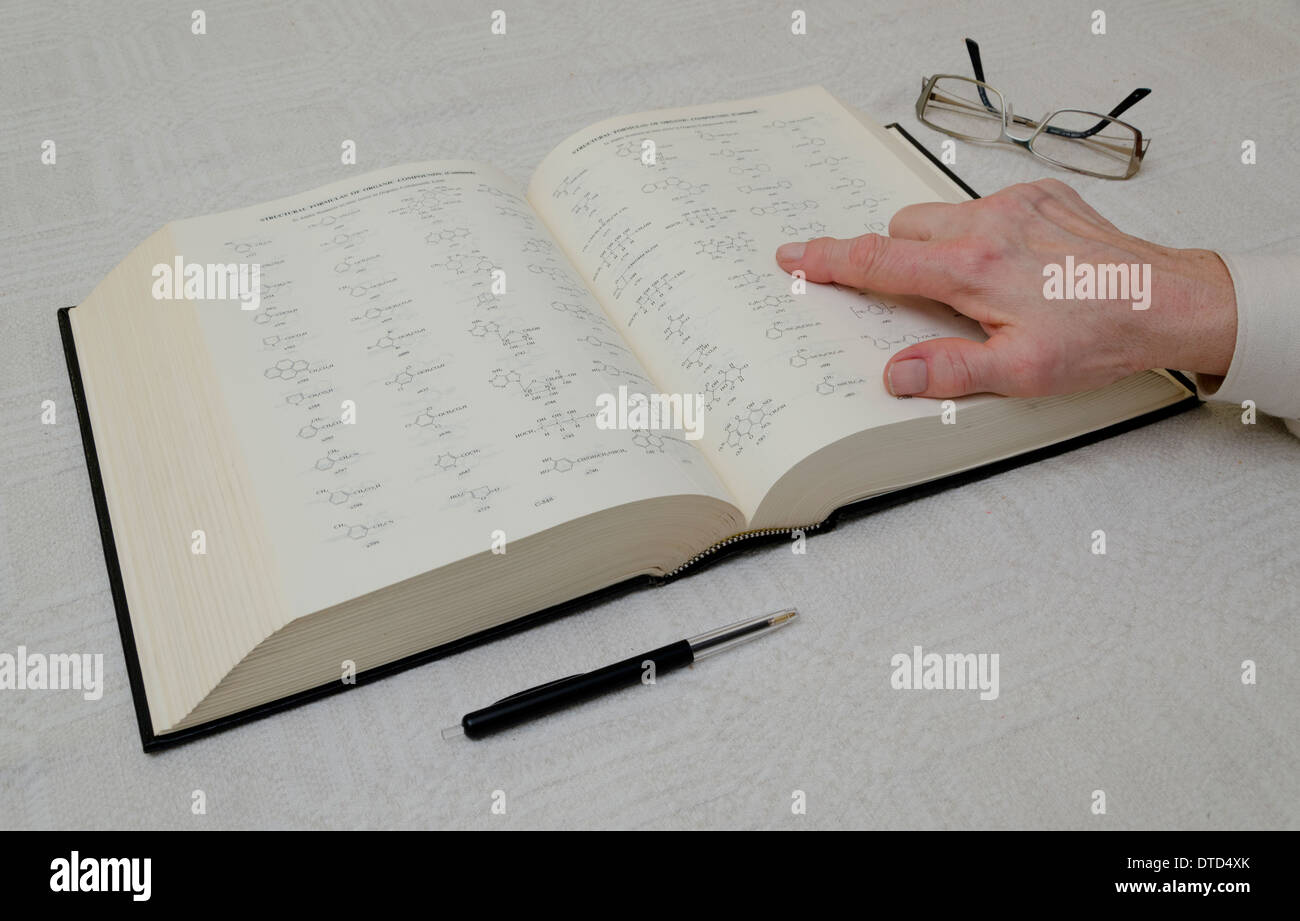 Chemistry teacher pointing on structural formulas of organic compounds Stock Photo