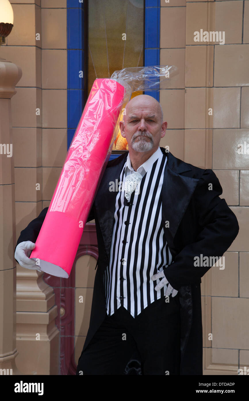 Giant stick of rock Blackpool  Lancashire, UK 15th February, 2014. Bryan Melton an Hysterical Histories performer at Blackpool's annual festival of circus, magic & new variety. - Stock Image