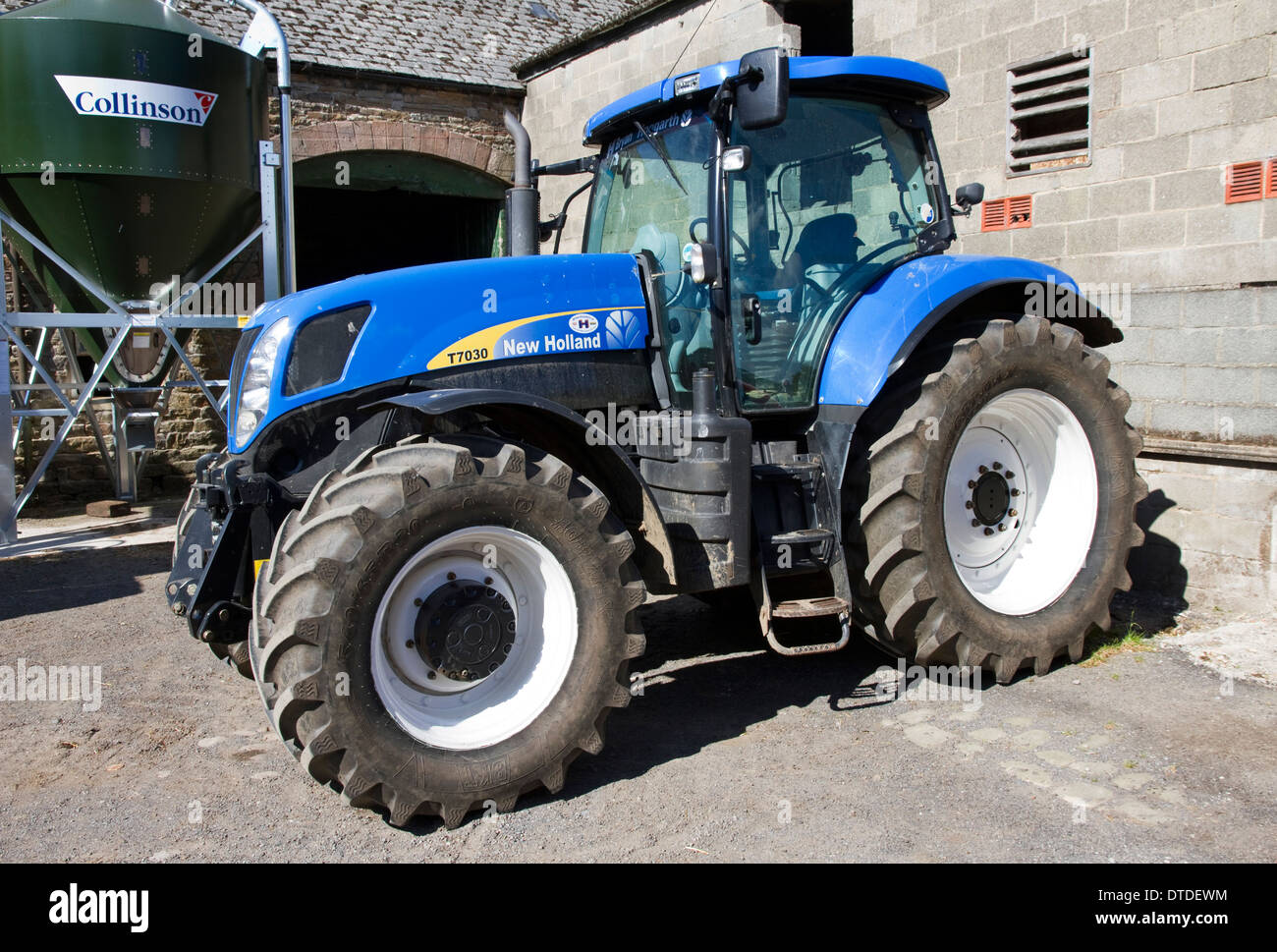 Tractor ( New Holland T7030 ) in farm yard, near Hurst Green