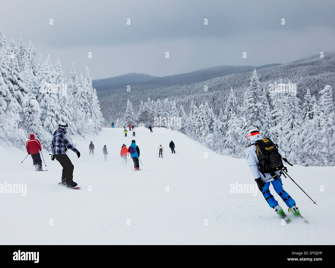 Mont-Tremblant , Quebec, Canada - February 9, 2014: Skiers are sliding down an easy slope at Mont-Tremblant Ski Resort. - Stock Image