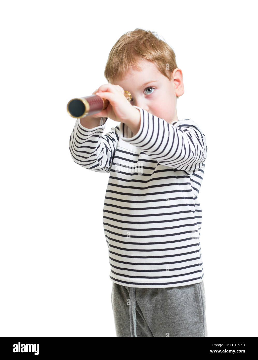 Kid boy looking ahead with telescope isolated - Stock Image