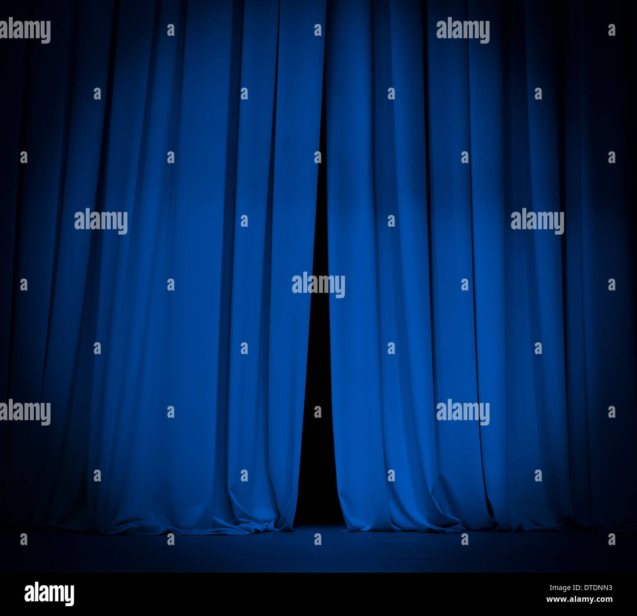 theater stage blue curtain with spotlight background - Stock Image
