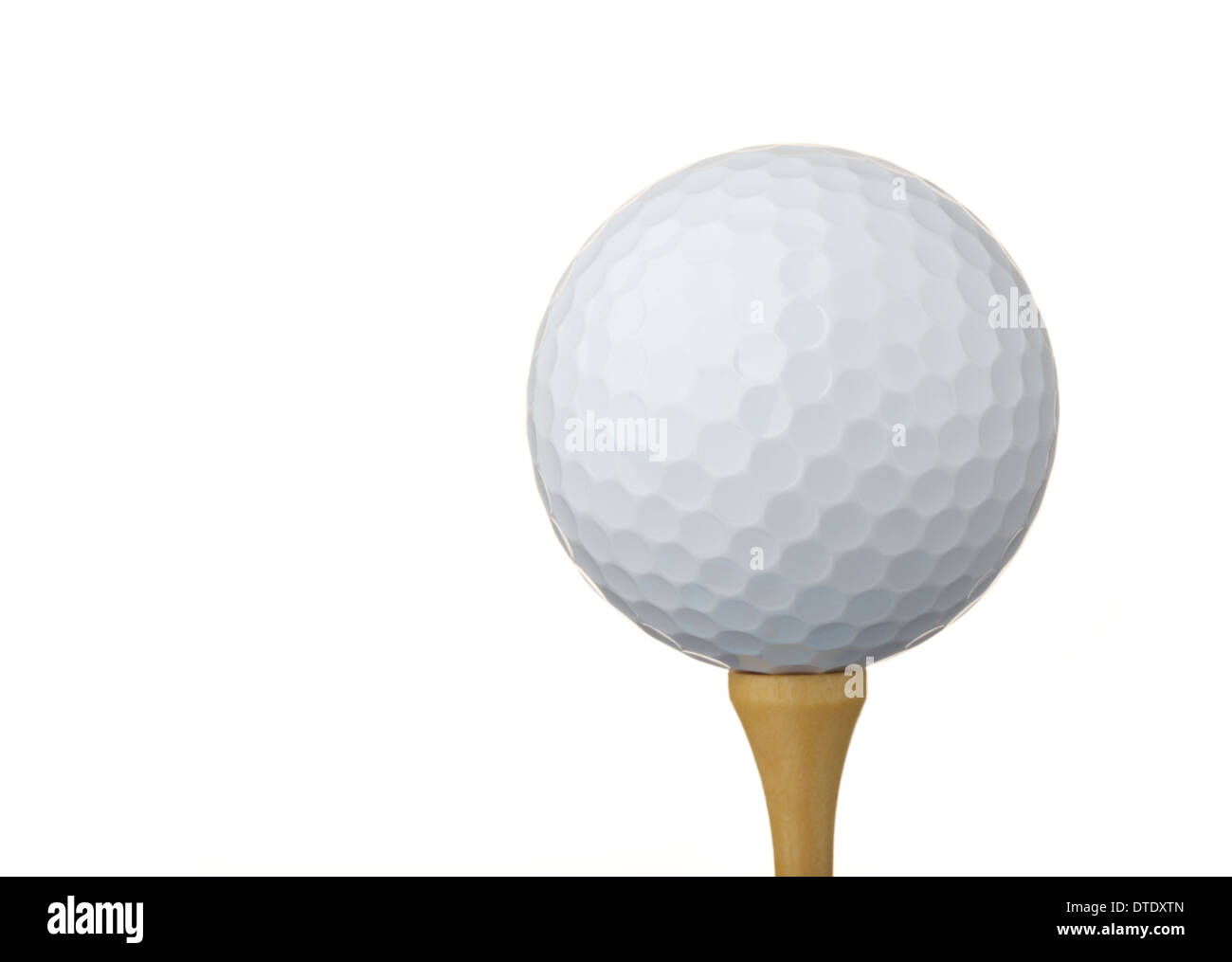 Golf ball on a tee, isolated on white background - Stock Image