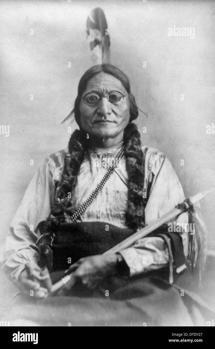Chief Sitting Bull, half-length portrait, seated, facing front, holding calumet, 1881 - Stock Image
