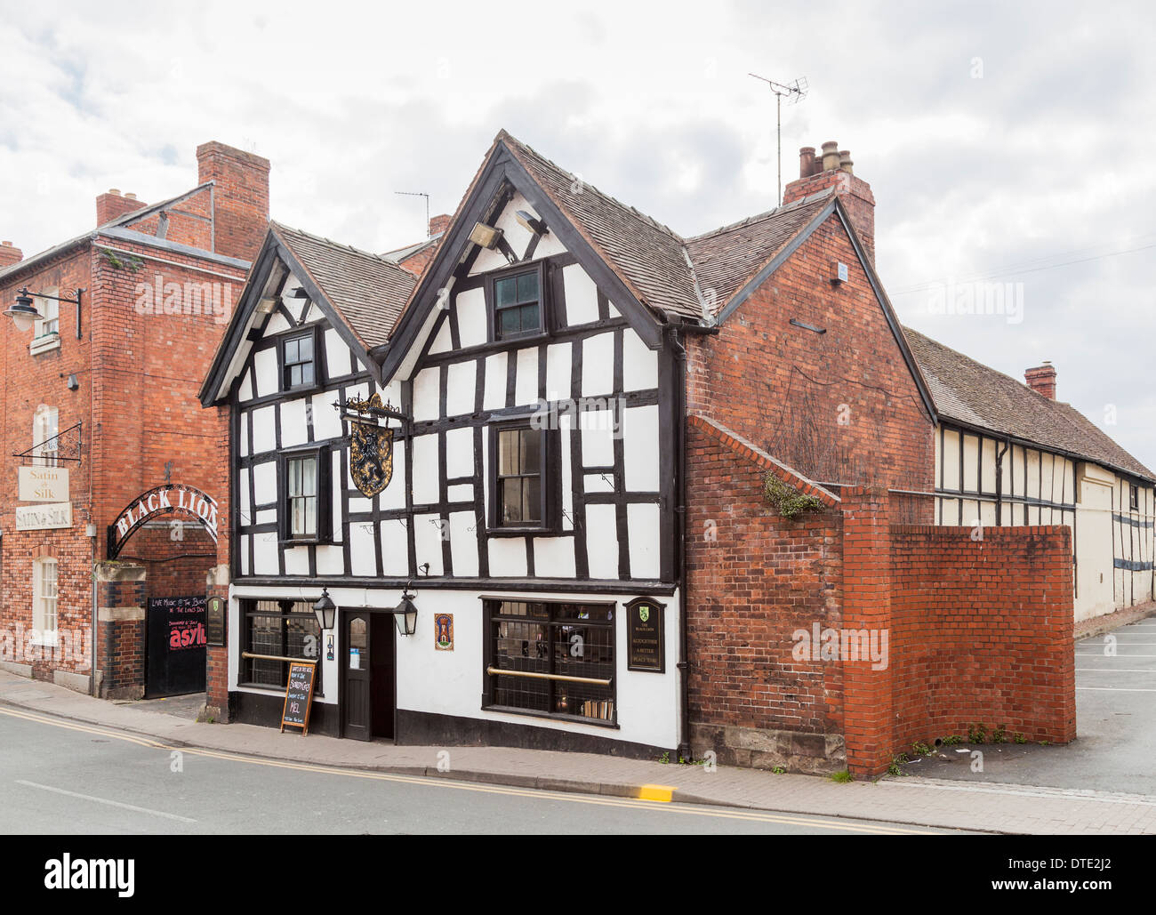 The Black Lion pub, a traditional historic timbered building in Hereford, UK - Stock Image