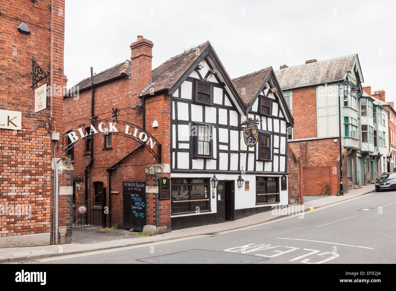 The Black Lion pub, a traditional historic black and white timbered building in Hereford, UK - Stock Image