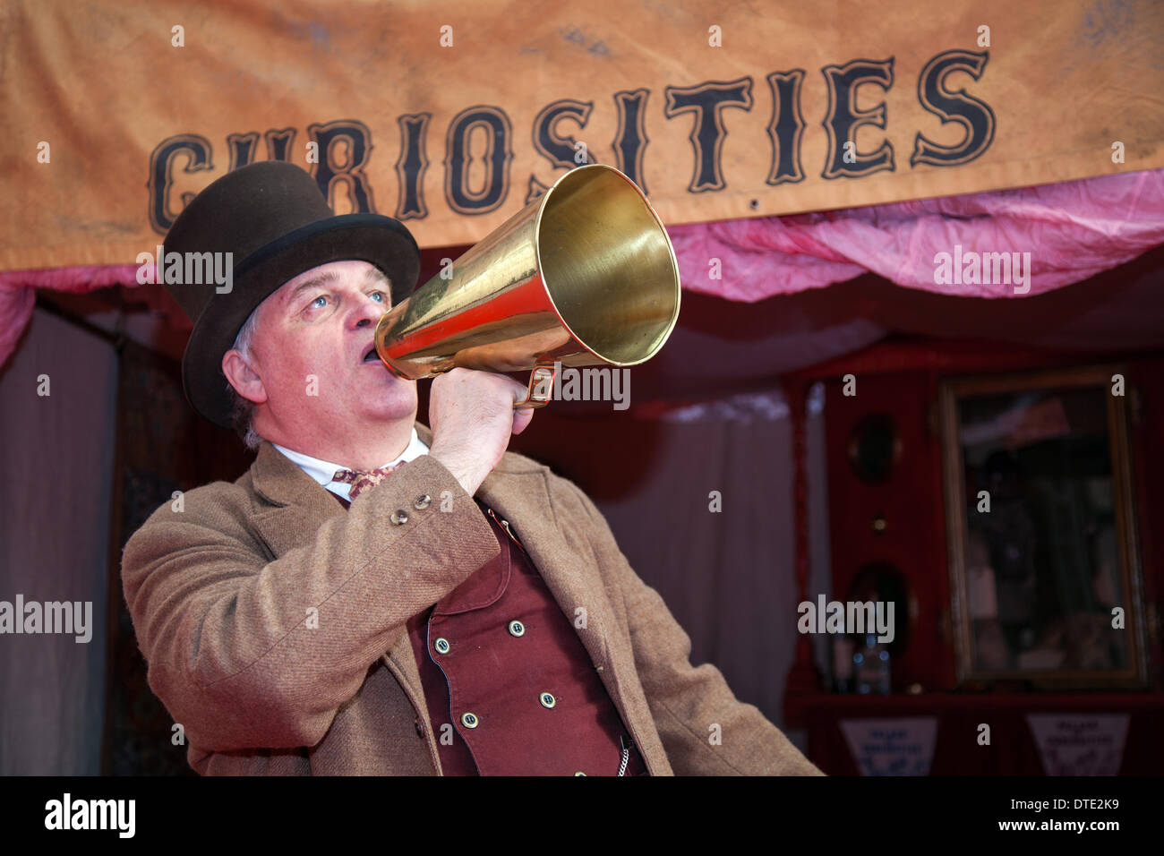 Blackpool, Lancashire, UK 16th February, 2014. Announcing through a brass megaphone, or loudhailer at the opening of the Victorian Palace of Curiosities performing at Blackpooll's annual festival of circus, side show, magic & new variety. - Stock Image