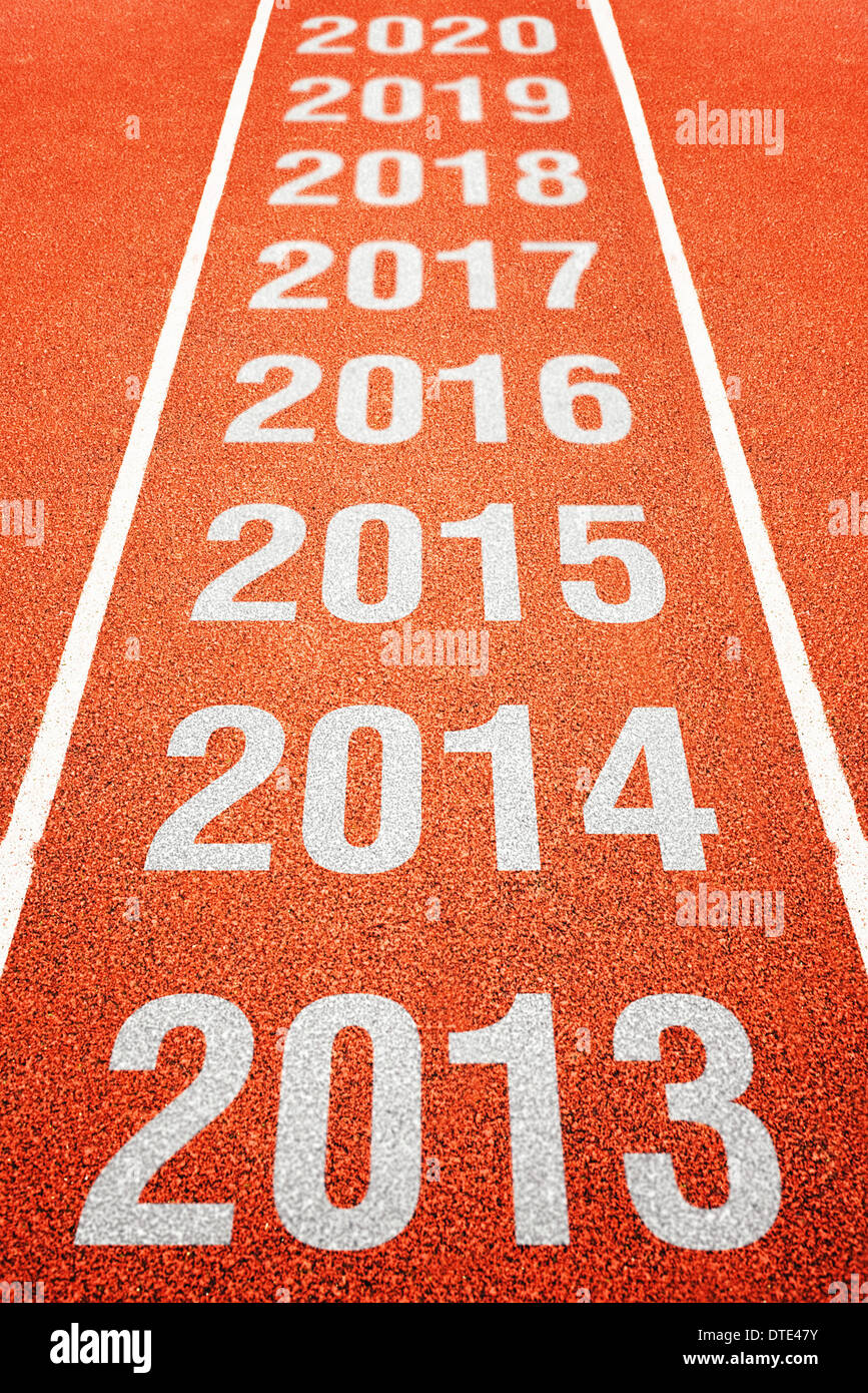 Continues Year Number on athletics running track. Happy new year. Running fast towards New Year. - Stock Image