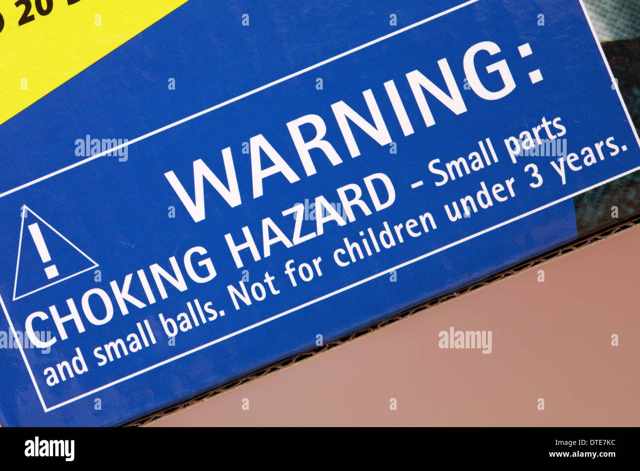 warning choking hazard small parts and small balls not for children under 3 years - information on box of children's game - Stock Image