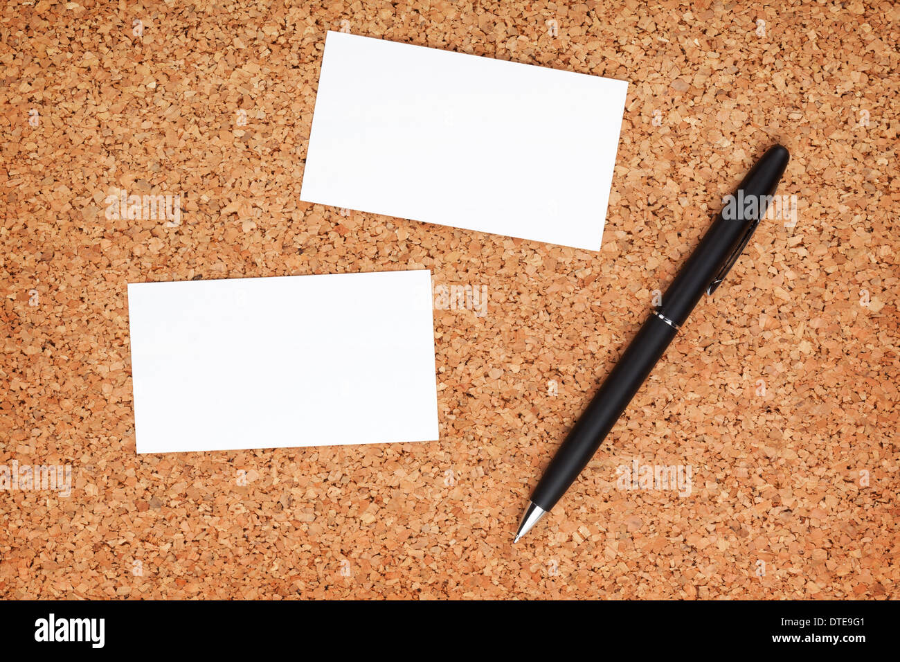 Two business cards and pen on cork wood notice board stock photo two business cards and pen on cork wood notice board colourmoves