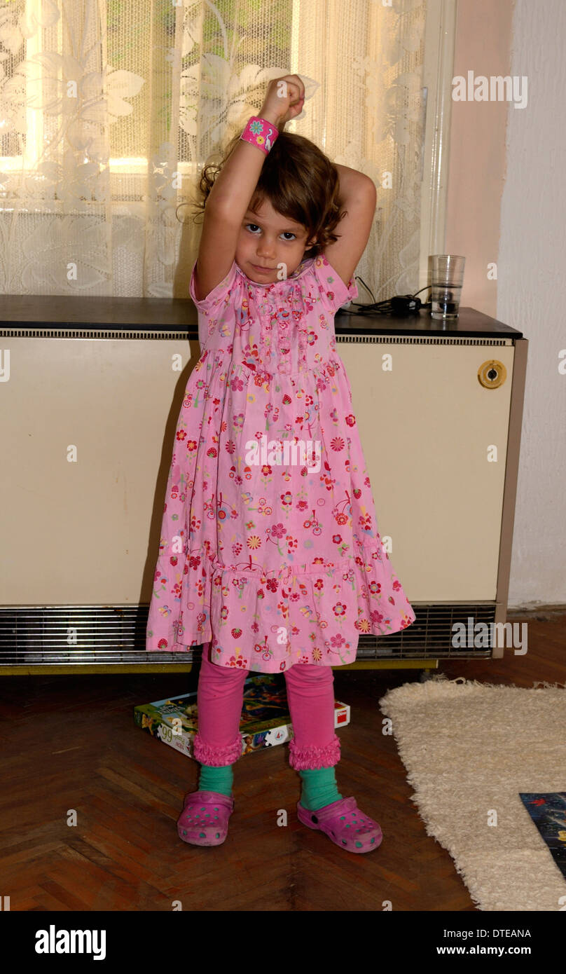 77b22d5512180 4 year old girl in pink dress at home Stock Photo  66698614 - Alamy