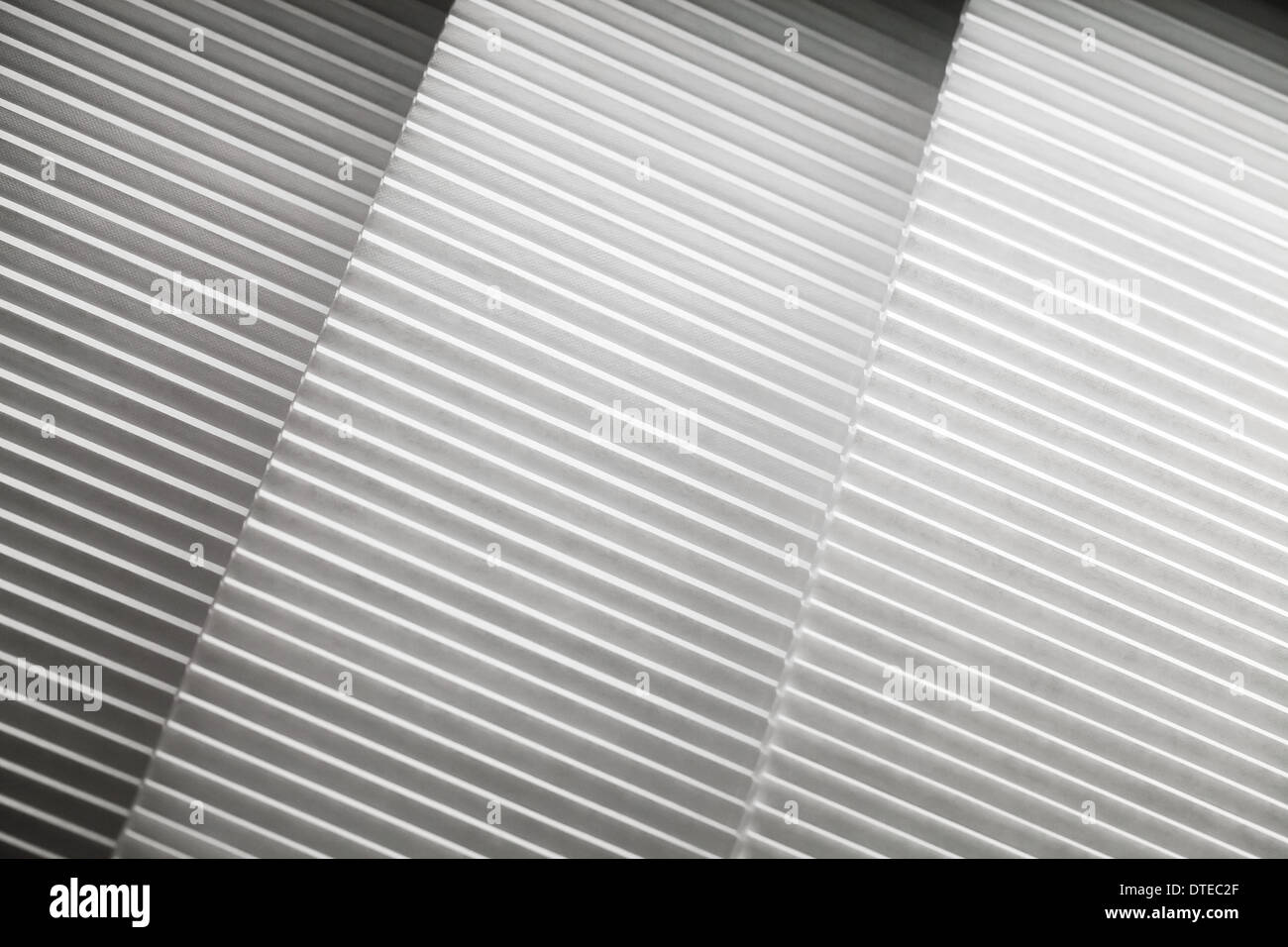 Abstract photo background with white louvers layers - Stock Image