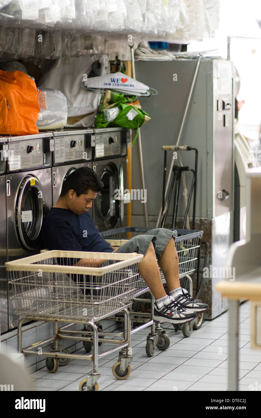 Laundromat wash stock photos laundromat wash stock images alamy man takes a nap in a basket inside a new york city laundromat craig solutioingenieria Gallery