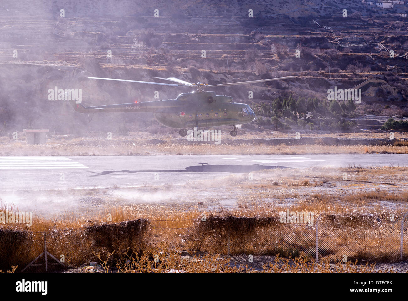 Nepali military helicopter is touching down near Jomson city - Stock Image