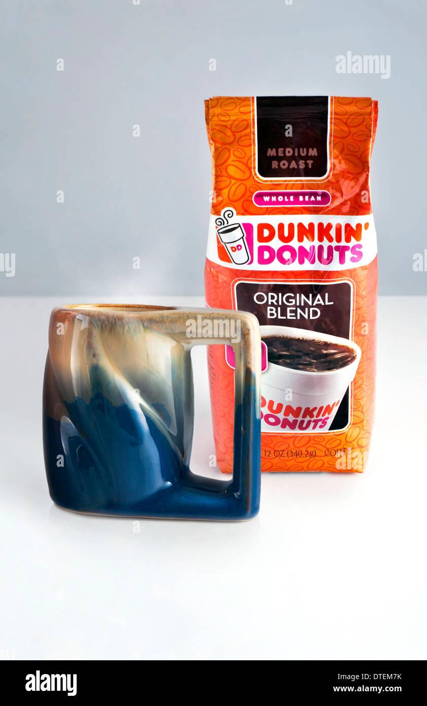 Dunkin Donuts Coffee and steaming mug of coffee - Stock Image