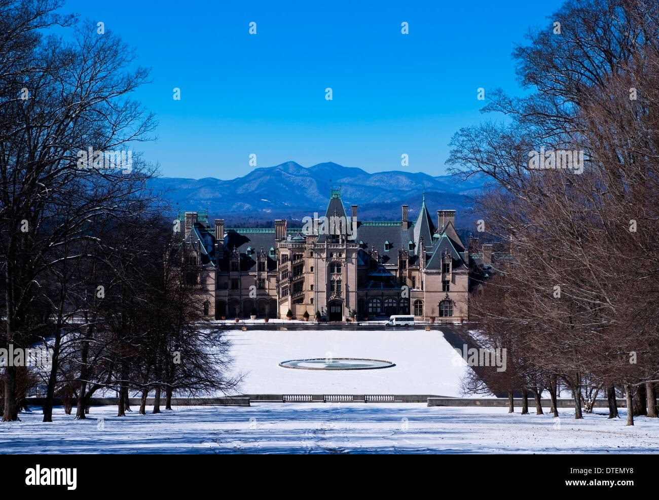The Biltmore Mansion, front View, with snow on the ground and mountains in the background, Asheville North Carolina - Stock Image