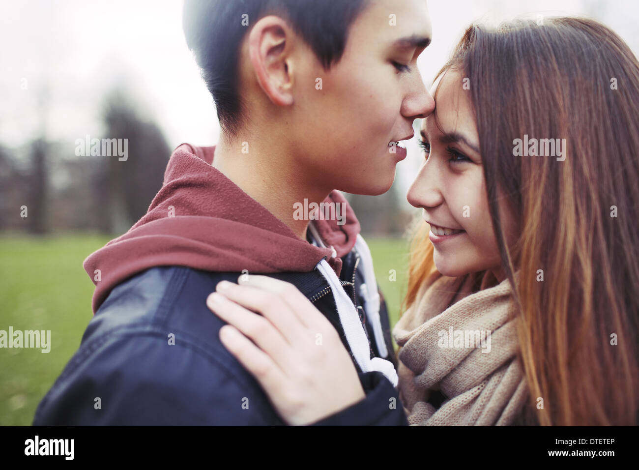 Close up image of cute young couple in love together in park. Asian teenage couple spending romantic time with each other. Stock Photo