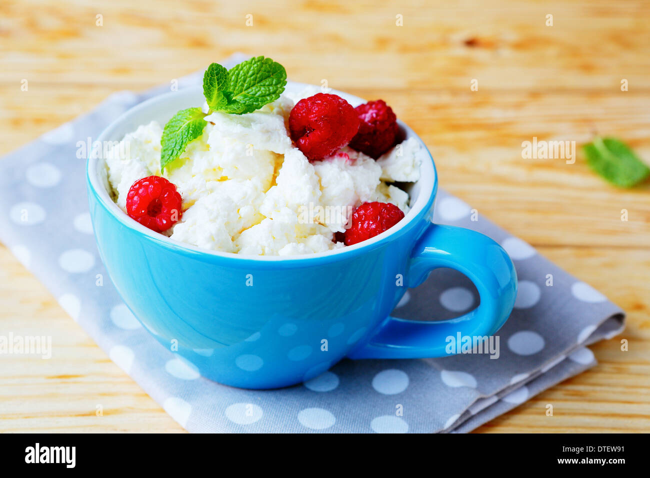 cottage cheese with fresh raspberries, food closeup - Stock Image