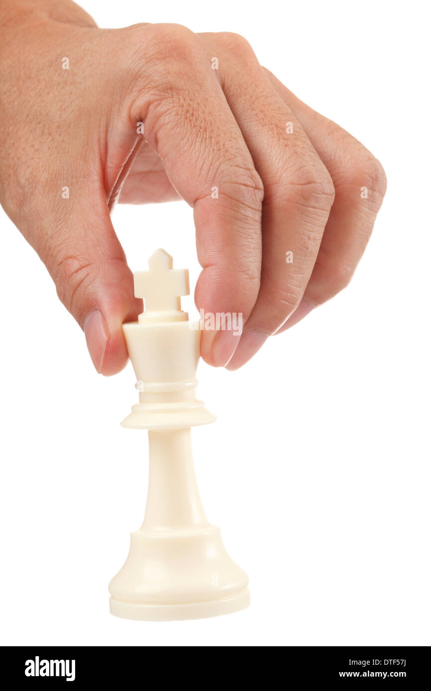 Asian male hand with a white chess king on white background - Stock Image