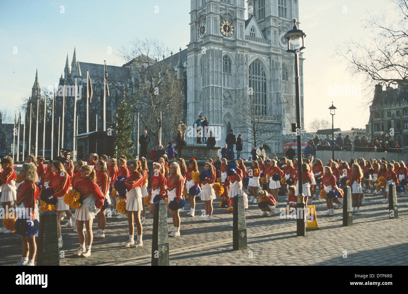 ANNUAL NEW YEAR PARADE . CHEER LEADERS ASSEMBLE IN FRONT OF WESTMINSTER ABBEY LONDON UK - Stock Image