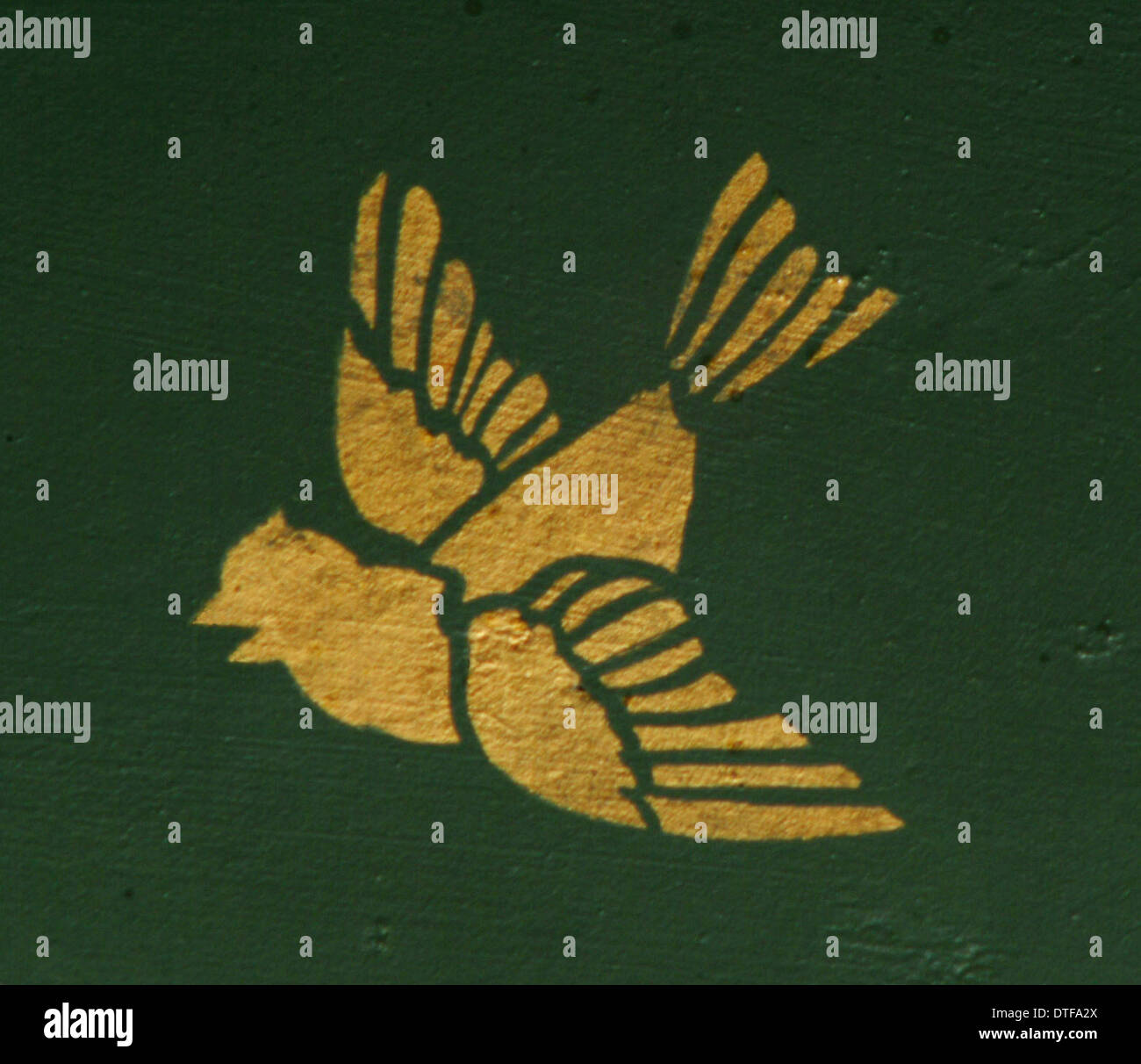 Bird from decorative ceiling panels - Stock Image