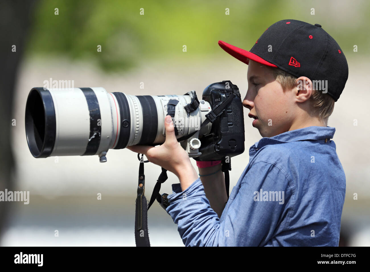 Hoppe Garden, Germany, boy photographed with a telephoto lens - Stock Image