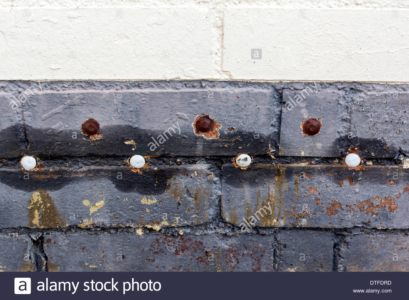 Close up of damp proofing on a brick wall - Stock Image