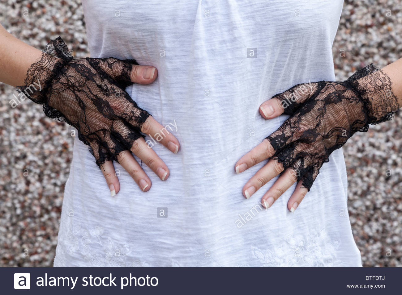Woman with hands on stomach - Stock Image