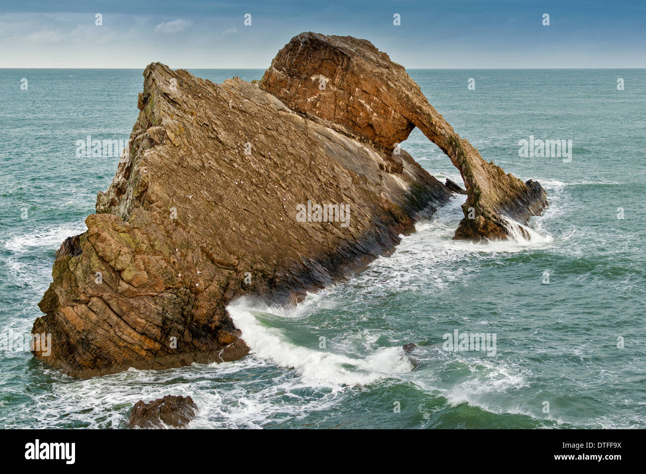 BOW FIDDLE ROCK NEAR PORTKNOCKIE  AND A STORMY SEA NORTH EAST COAST MORAY FIRTH SCOTLAND Stock Photo