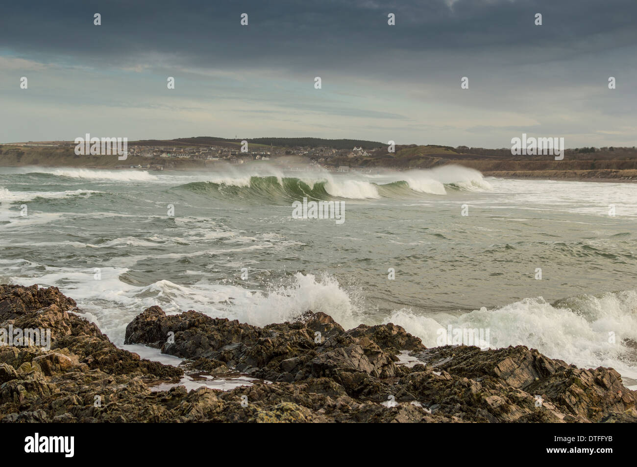 STORMY SEAS AND CRASHING WAVES WHITE HORSES IN CULLEN BAY MORAY SCOTLAND - Stock Image