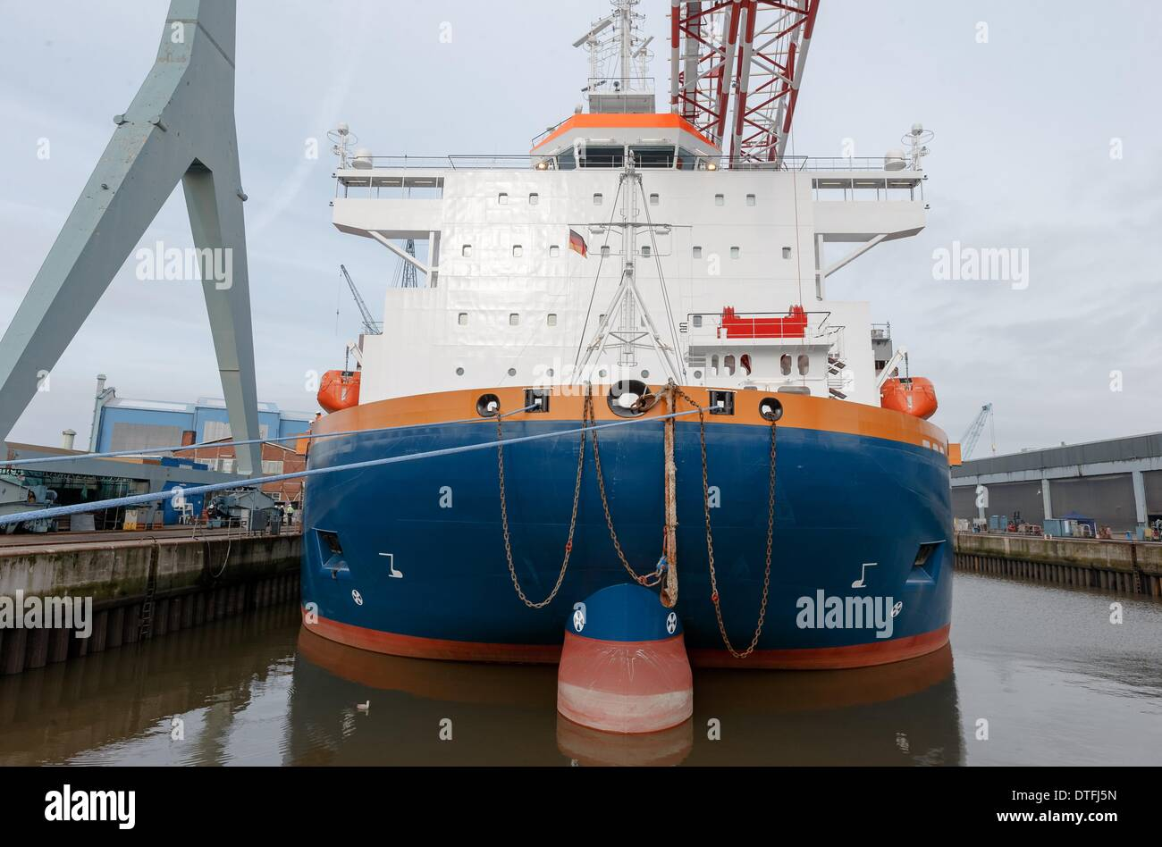 Hamburg, Germany. 17th Feb, 2014. Wind turbine installation vessel Aeolus is moored at the Sietas shipyard in Hamburg, Germany, 17 February 2014. Aeolus is the first wind turbine installation vessel to be designed and built in Germany and will be used by Van Oord for the construction of wind turbines at the Eneco Luchterduinen wind park from July 2014. Photo: MARKUS SCHOLZ/DPA/Alamy Live News - Stock Image