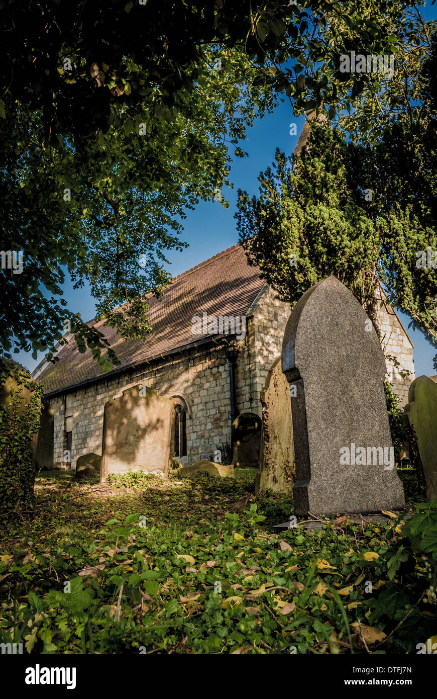 Gravestones in churchyard - Stock Image