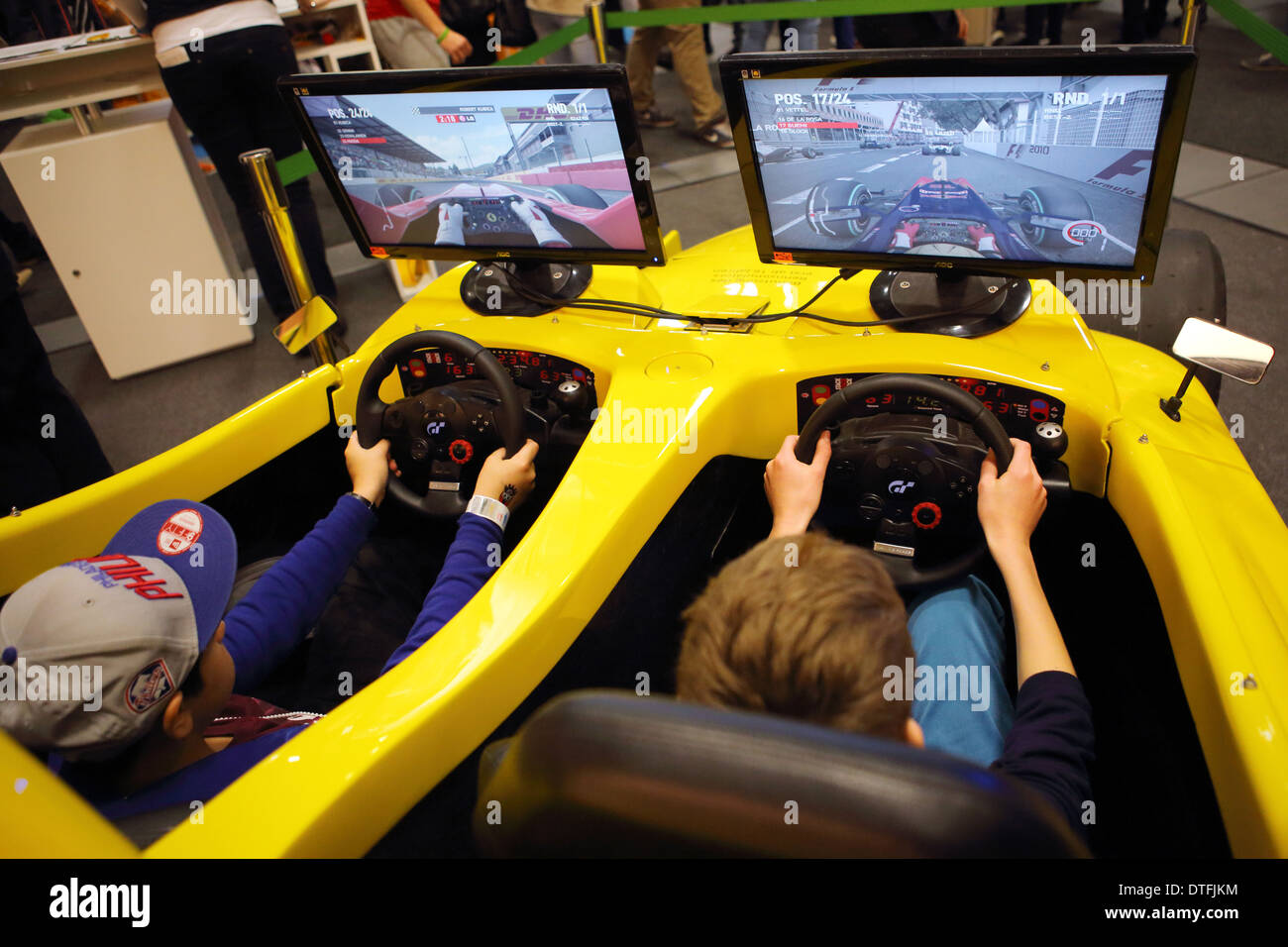 Berlin, Germany, young people sitting at the youth fair YOU in a Formula 1 simulator - Stock Image