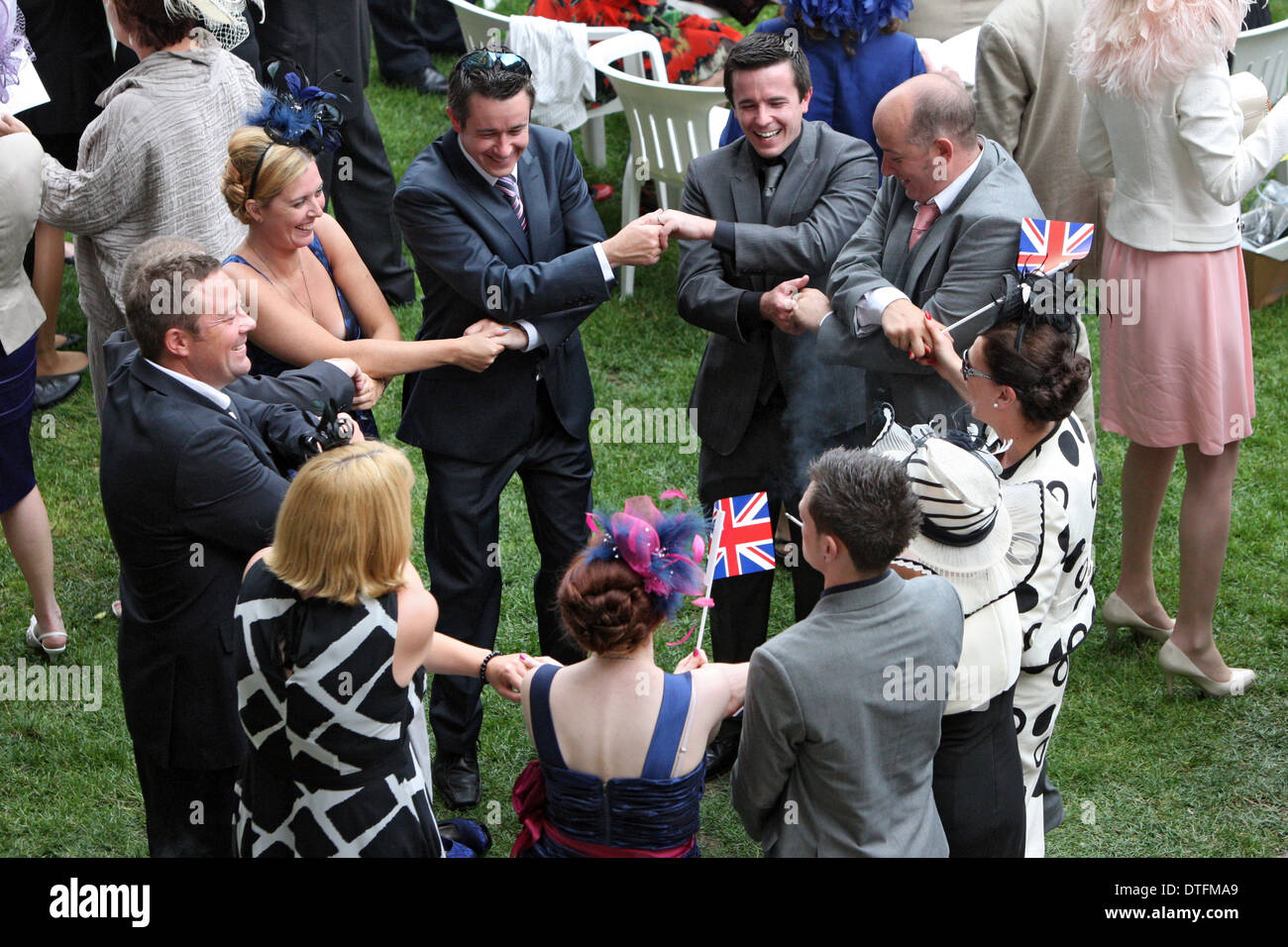 new styles 01c27 c4519 Ascot, United Kingdom, men and women form a circle and hold hands at the