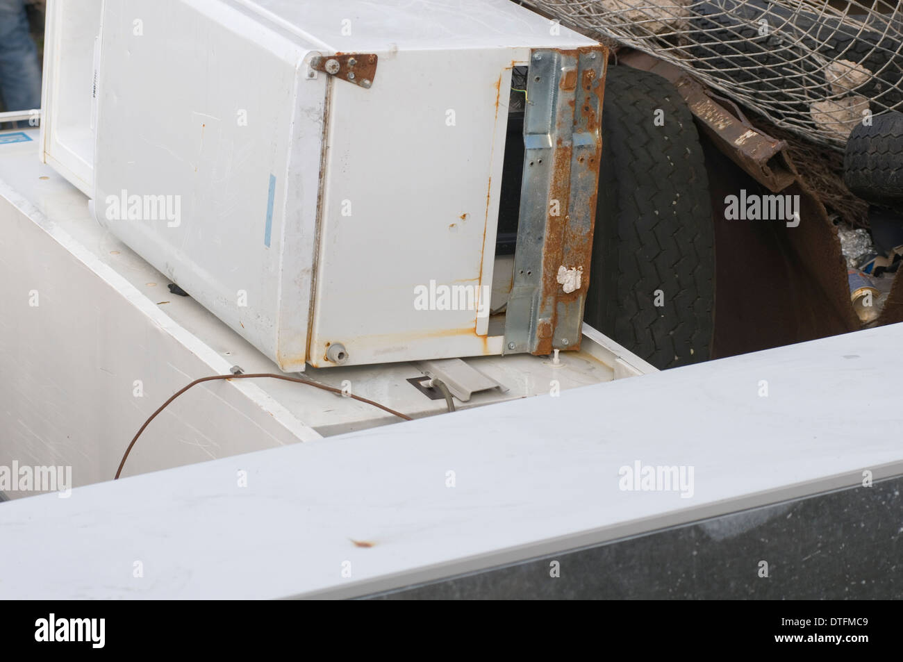 old fridge fridges disposed of at roadside fly tipped tipping tippers tippers degassed de gassed gassing degassing white goods o - Stock Image