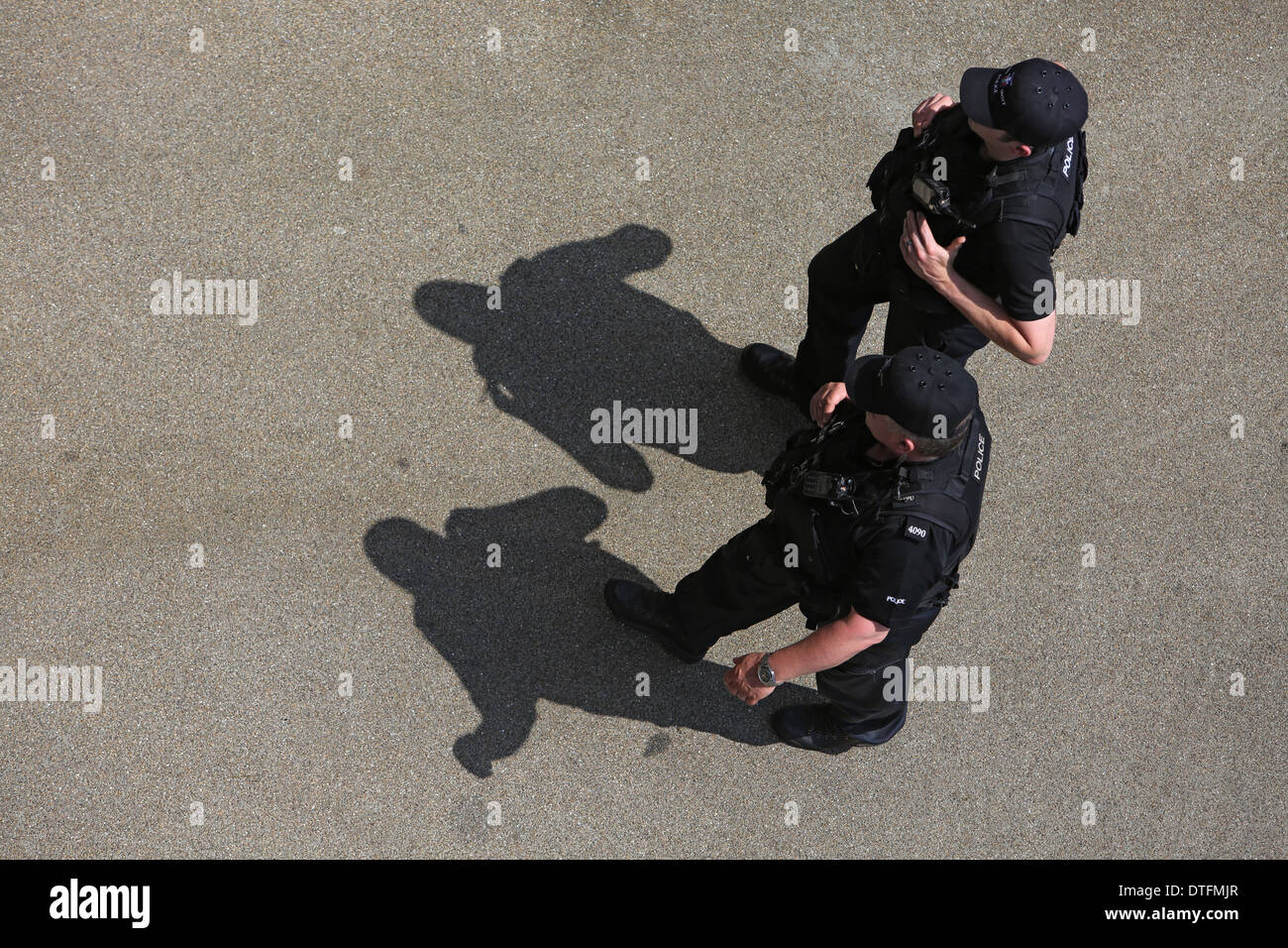 Ascot, United Kingdom, police officers run along a road - Stock Image