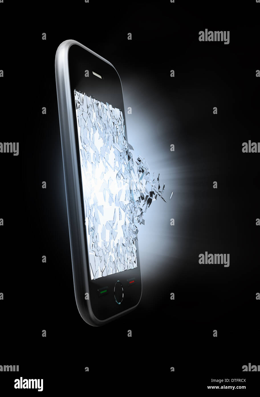 A smart phone display screen being shattered  - Stock Image