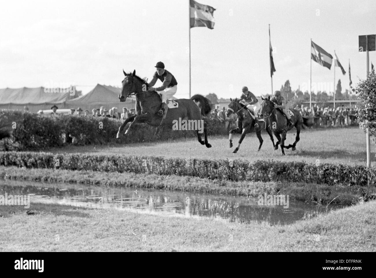 Hamburg, Germany, horse and jockey jumping over a ditch Stock Photo