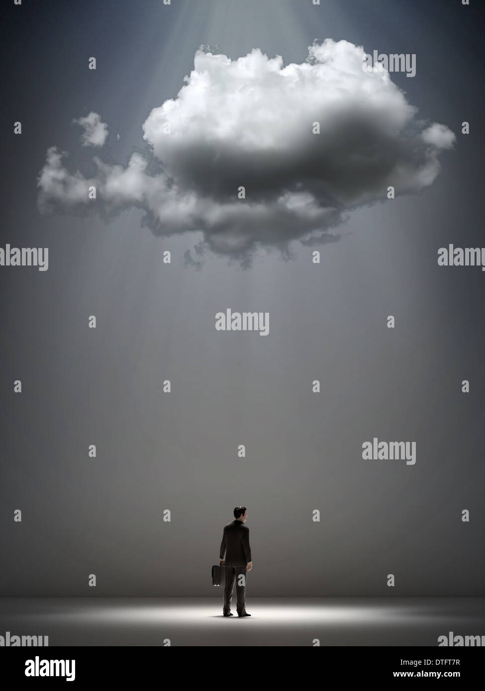 A cloud over a businessman - straggle and opportunity concept - Stock Image