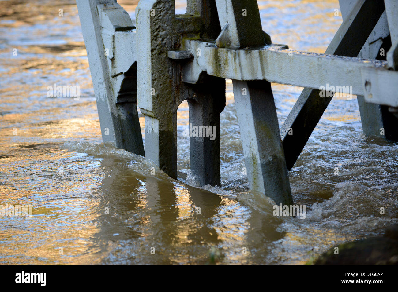 The Ironbridge in Shropshire under pressure from the River Severn in flood - Stock Image
